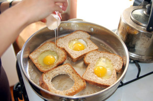making_eggs_in_basket-300x199