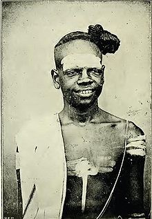 Namboothiri, notice the sacred thread and the tuft of hair to the ...