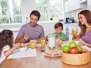 TS-161146814_family-with-small-kids-eat-in-kitchen-breakfast_lg